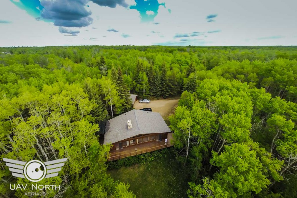 Aerial photo of a secluded cabin real estate listing