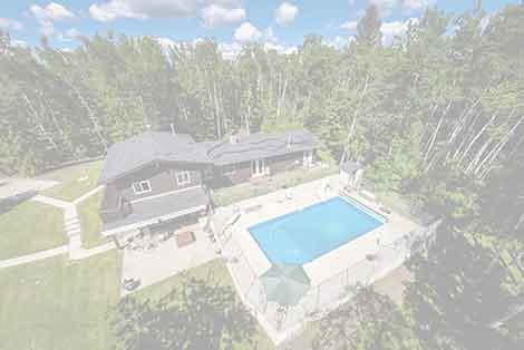 Real estate aerial photo of an acreage with a large pool