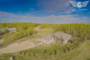 Aerial photo of an Edmonton area ranch with a rainbow in the west sky!